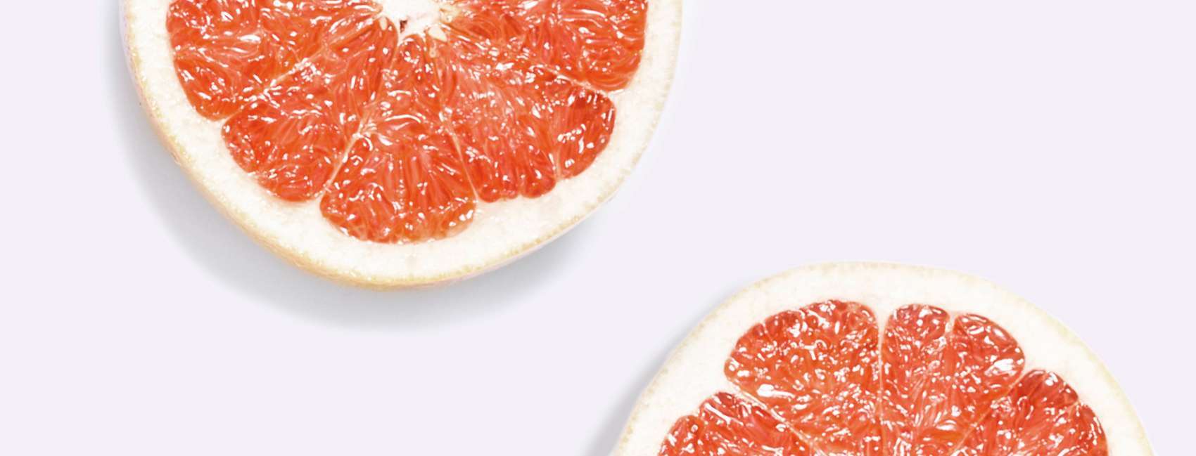 Cross section of grapefruit on grey background