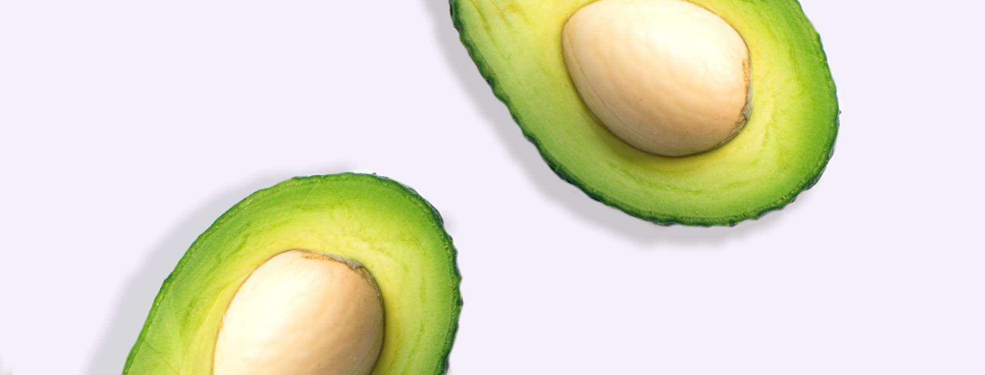 Cross section of avocado on grey background