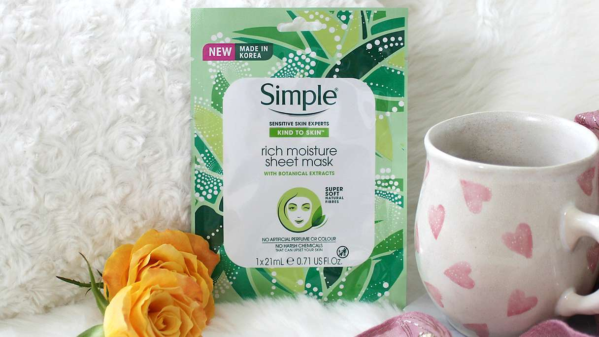Styled shot Simple Rich Moisture Sheet Mask with yellow roses and mug