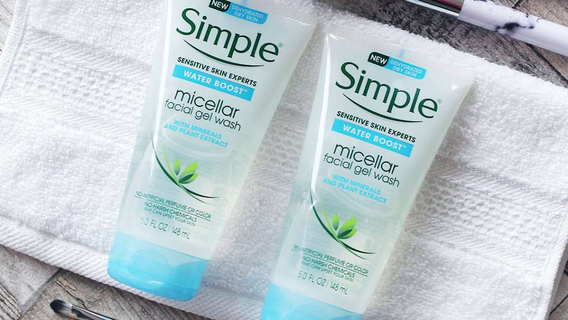 Two micellar gel cleansers lying on face cloth