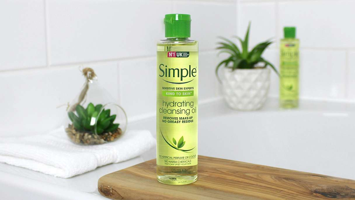 Bottle of Simple Hydrating Cleansing Oil in bathroom setting