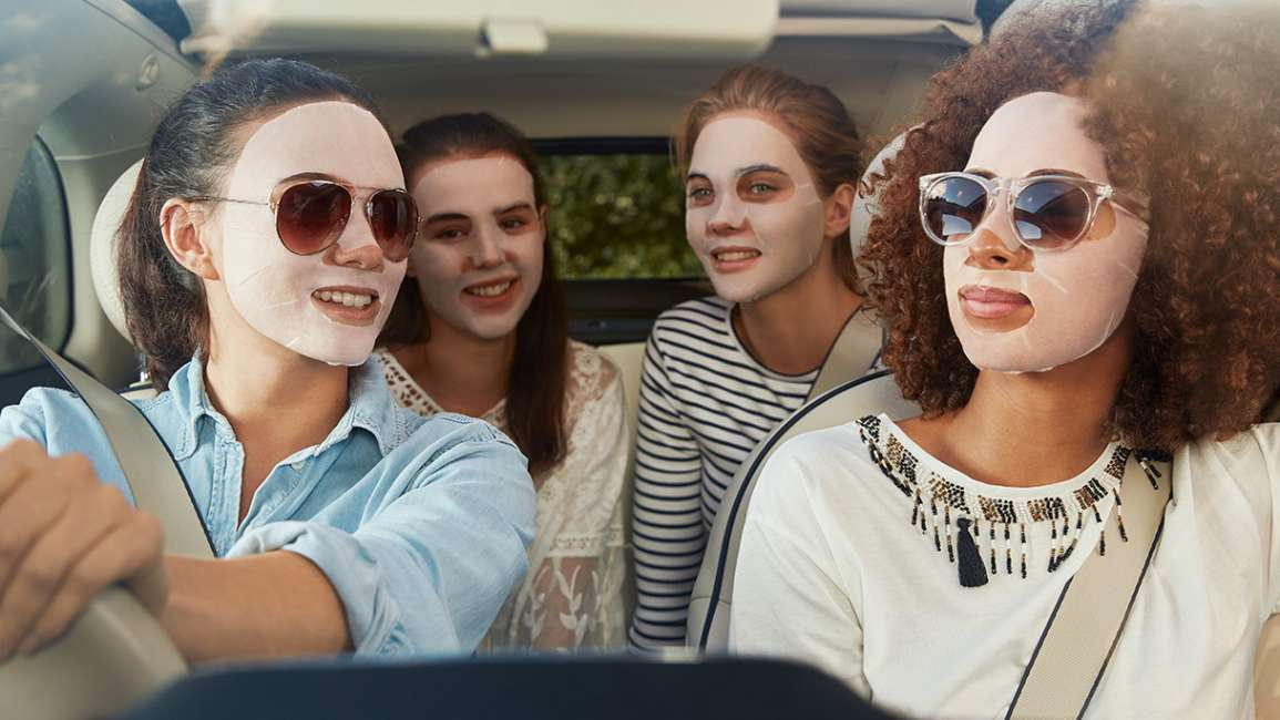 Four girls in the car wearing Simple Sheet Masks