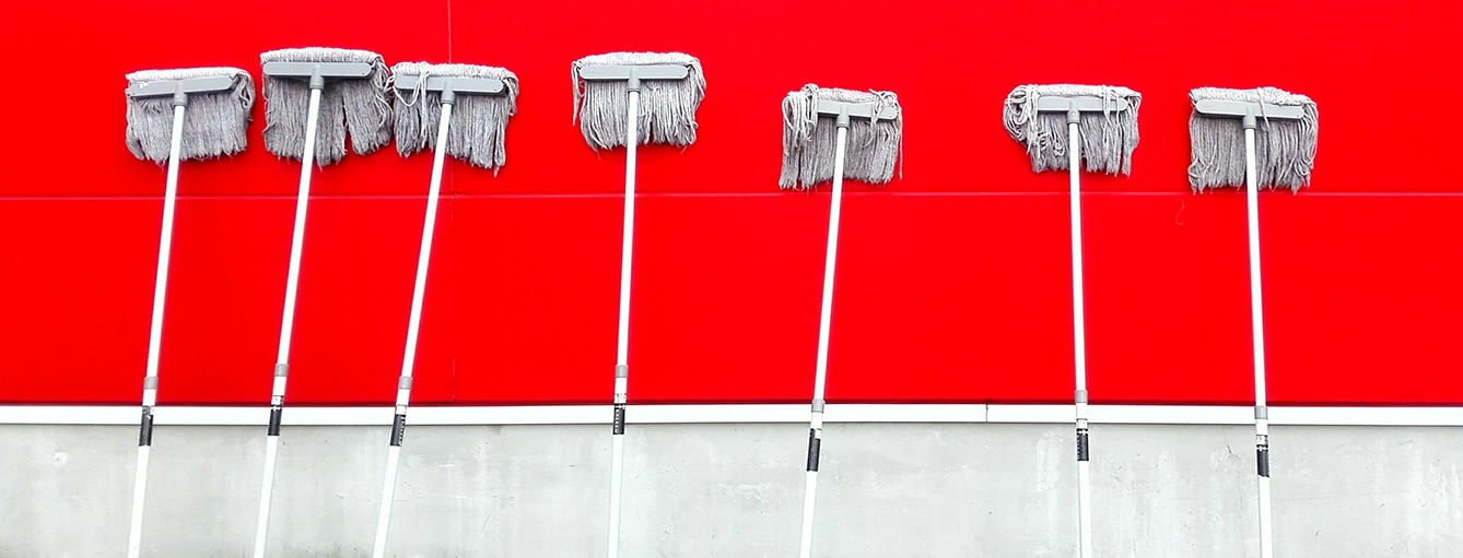 red wall mops standing up