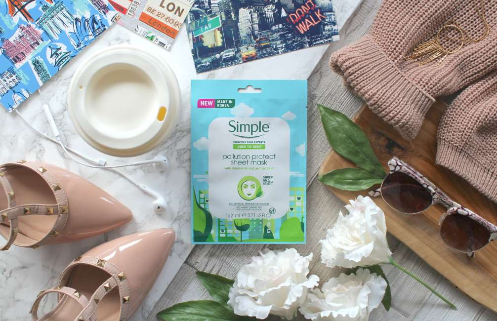 Simple Kind to Skin Pollution Protect Sheet Mask flatlay surrounded by shoes and flowers